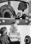 Georgetown Public Library - children watch a puppet show.