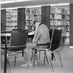 Joseph Gibbons School - pupil in library.