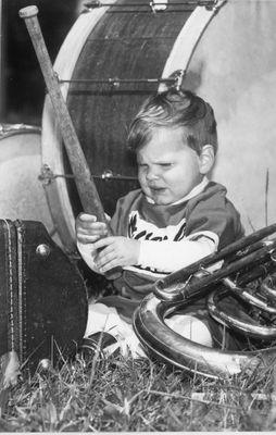 Dougie Ballentine Plays with a Baseball Bat Beside a  Bass Drum After Minor Baseball Day Parade.