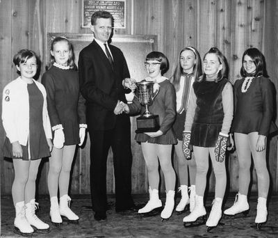 Young figure skaters receive their awards from Tom Pettingill