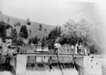 GLENPeople on foot bridge over the dam c1940