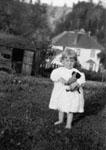 Una Hill standing in the back garden of 3 Tweedle 1921