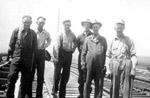 Workmen standing on trestle (1945)