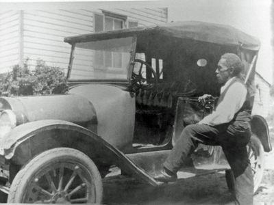John Henry Shepherd Standing with Car