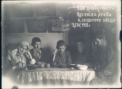 The Bokan family share a meager meal marking three hundred days without the consumption of bread.