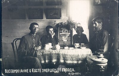 Nikolai Bokan and three of his sons commemorate the death of Konstantin Bokan, who died of starvation.