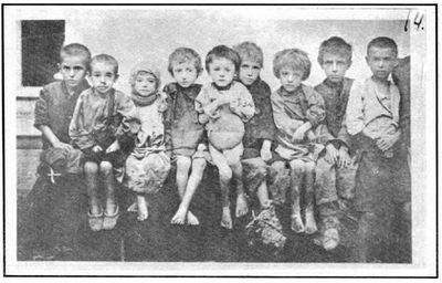 Non-Holodomor: Several children in Ukraine seated in a row, showing evidence of starvation