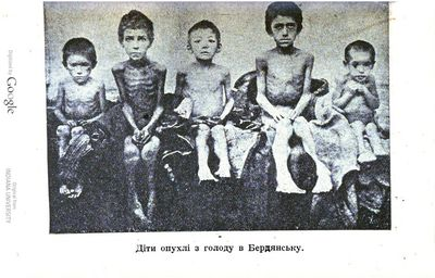 Non-Holodomor: Five boys in Ukraine, stripped down and seated in a row, showing evidence of starvation and swelling