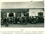 Crowd of people waiting to enter a store selling rationed food in Kharkiv
