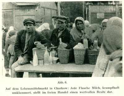 Several people at an open air food market in Kharkiv selling milk
