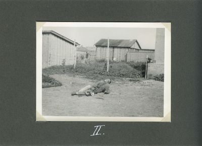 A starving farmer tries to lean on an elbow as he lies near a house in Kharkiv (Death by starvation series, no. 2)