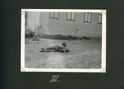 A farmer is dying of starvation near a house in Kharkiv. (Death by starvation series, no. 3)