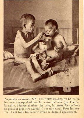 Non-Holodomor: Two young boys at a medical facility in Russia, the older child feeding the younger