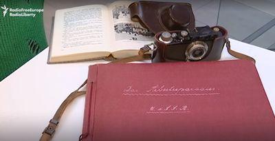 Display of Alexander Wienerberger's camera, memoir, and red album