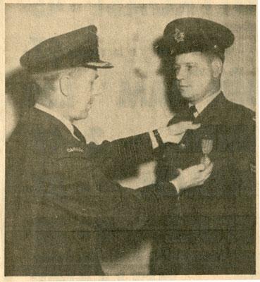 Corporal Ralph Allen Receiving 12 Year Service Decoration.