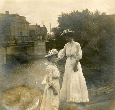View across Muskoka River at the swing bridge, Huntsville, Ontario. Dr. Howland's General Hospital on left.