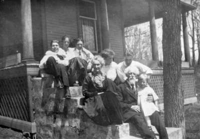 Wardell family on porch of 12 West Road, Huntsville, Ontario.