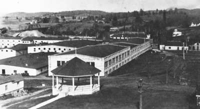 Anglo Canadian Leather Company, Huntsville, Ontario 1905-1960. Susan Street Bandstand in foreground.