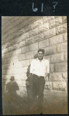 Unidentified Man Leaning on a Wall