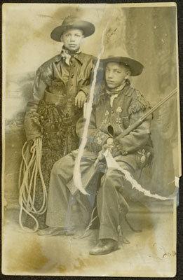 Two Boys Dressed Like Cowboys