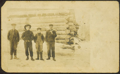 Four Unidentified Men in Front of a Log Cabin