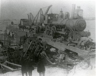 Railway crew working to repair bridge from flood damage