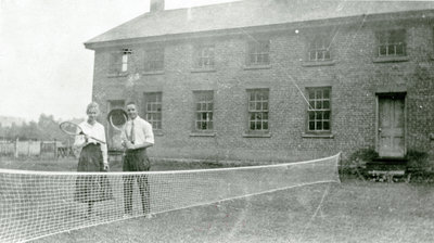 Two tennis players in front of the Doon Twines boarding house, Doon, Ontario