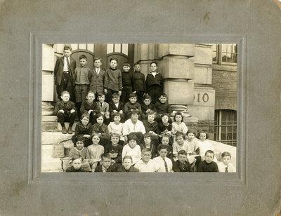 "Portrait of ""Jun R.2"" class on steps of Victoria School, Kitchener"