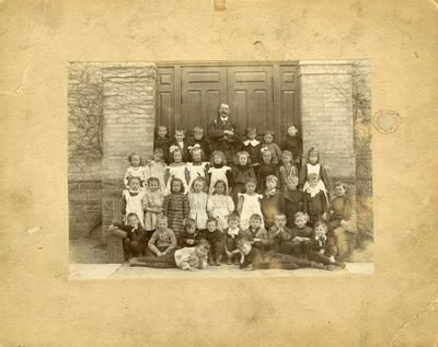Class of school children with teacher