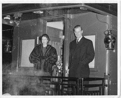 Royal Visit, 1951 - Princess Elizabeth & Prince Philip standing on rear platform of train, London, Ontario