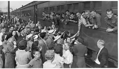 World War II: Unidentified group of well wishers and soldiers at train station, London, Ontario