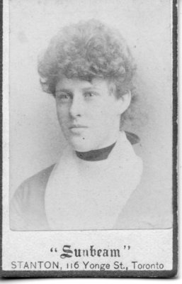 Portrait of an unidentified young woman with curly hair upswept hair, London, Ontario