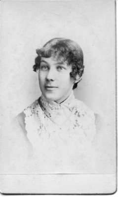 Portrait of an unidentified young woman with short curls around her face.