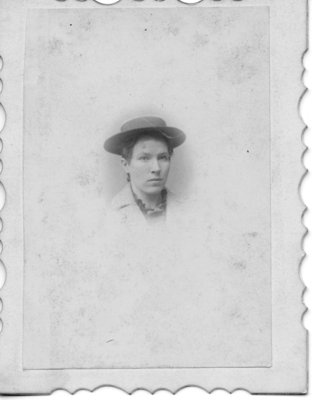 Head and neck portrait on an unidentified young woman in a felt boater hat.
