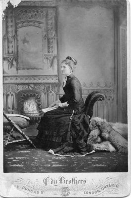 Portrait of an unidentified seated woman in a black dress, London, Ontario