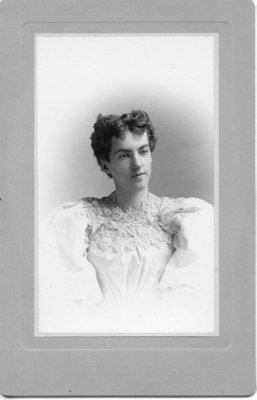 Portrait of an unidentified young woman in elegant lace trimmed dress