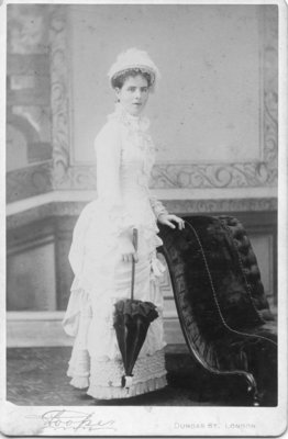 Portrait of an unidentified young woman dressed in a light coloured dress and hat, London, Ontario