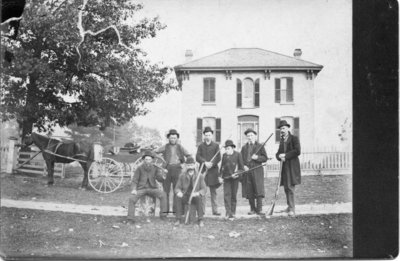 Portrait of Mr. Sisson and companions at his home, Byron, Ontario