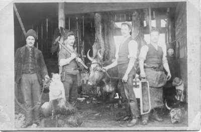 Portrait of a group of unidentified men at a slaughterhouse, London, Ontario
