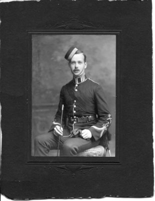 Formal portrait of an unidentified seated cadet