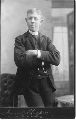Portrait of an unidentified young man in a dark suit, London, Ontario