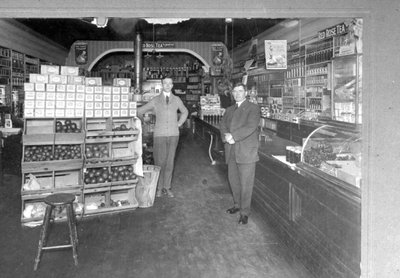 Jack Hannant Sr. (right) at his grocery store.