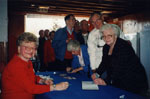 """Book Launch - """"P.L. Inventor of the Robertson Screw.""""  Audrea Lear-Costigan greets past employees of the P. L. Robertson Manufacturing Co. Ltd. at the Milton Fairgrounds."""