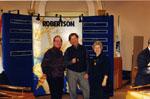 New Year's Levee, 1999.   Walt Elliott, Rick Day, Anne Elliott at the P. L. Robertson display