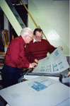 """Milton Historical Society.  Ken Lamb and Don Hayward checking proofs for """"Milton Remembers World War II, 1939-1945""""."""