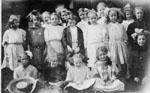 Large group of little girls in summer outfits