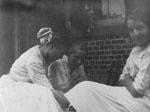 Three women seated on porch