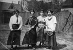 Four young ladies with tennis racquets