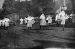 Women dancing on lawn