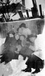 Six women posed on snow bank